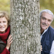 Royalty-Free Stock Photo: Married couple leaning against tree