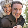 Affectionate couple taking a walk through park — Stock Photo