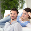 Couple in front of television — Stock Photo