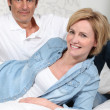 Couple lying on bed — Stock Photo