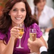 Couple in a restaurant drinking champagne — Stock Photo