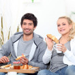 Stock Photo: Young couple sharing breakfast in lounge