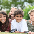 Children lying in the grass - Stock Photo