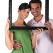 Couple behind black frame - Stock Photo