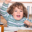 Kids having breakfast at home — Stock Photo