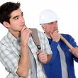 Builder stood with young apprentice — Stock Photo
