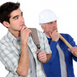 Builder stood with young apprentice — Stock Photo #7803538