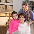 Girl with her mother and grandmother - Stock Photo