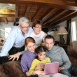 Stock Photo: Family in front of a computer