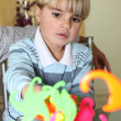 Young boy playing with colourful shapes — Stock Photo