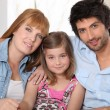 Foto Stock: Happy parents with daughter