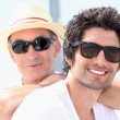 Father and son wearing sunglasses — Stock Photo #7804516