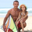 Man on a beach with his daughter and a kite — Stock Photo #7804715