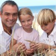 Family at the beach — Stock Photo #7805111