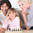 Family playing chess — Stock Photo #7805345
