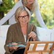 Mother and daughter painting — Stock Photo #7805430