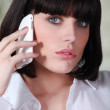 Woman talking on her mobile phone — Stock Photo #7805689