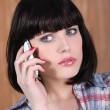 A brunette woman at phone — Stock Photo #7805711