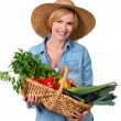 Blond carrying a basket full of vegetables. — Stock Photo