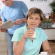 Mature couple drinking milk — Stock Photo #7807140