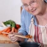 Senior woman cooking — Stock Photo #7808191