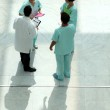 High angle view of a medical team chatting in an atrium — Stock Photo #7808416