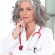 Portrait of mature female doctor — Stock Photo