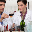 Couple in a wine laboratory — Stock Photo #7808769