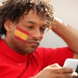 Spanish football supporter with mobile telephone — Stock Photo #7808963