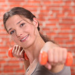 Woman in gym class — Stock Photo