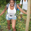 Two hikers with backpacks in forest — Stockfoto #7809398