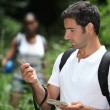 Couple in woods orienteering — Stock Photo