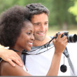 Couple taking photos outdoors — Stock Photo #7809593
