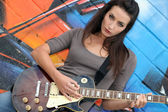 Musician with her guitar — Stock Photo