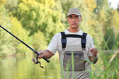 Freshwater fisherman — Stock Photo