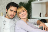 Content young couple at home — Stock Photo