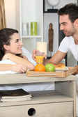 Couple enjoying romantic meal in bedroom — Stock Photo