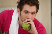 Man about to eat an apple — Stock Photo