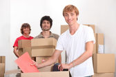 Trio of friends moving in together — Stock Photo
