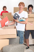 Lads packing boxes — Stock Photo