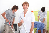 Young men cleaning — Stock Photo