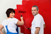Married couple painting wall — Stock Photo