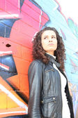 Woman in front of graffiti — Stock Photo