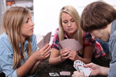 Portrait of teenagers playing cards — Stock Photo