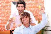 Homosexual couple in restaurant — Stock Photo