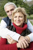 Couple hugging in park — Stock Photo