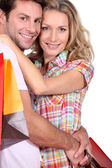 Portrait of a couple with shopping — Stock Photo