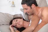 Man waking up his cranky wife — Stock Photo