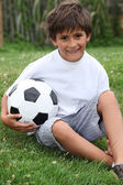 Little boy with football — Stock Photo