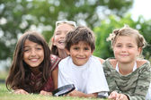 Children lying in the grass — Stock Photo